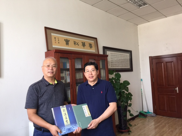 Dr. Decheng Chen had a meeting with Dr. Wang, Fuchun, Dean of College of Acupuncture Orthopedics on August 24, 2015
